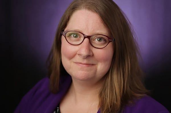Dr. Lora Helvie-Mason