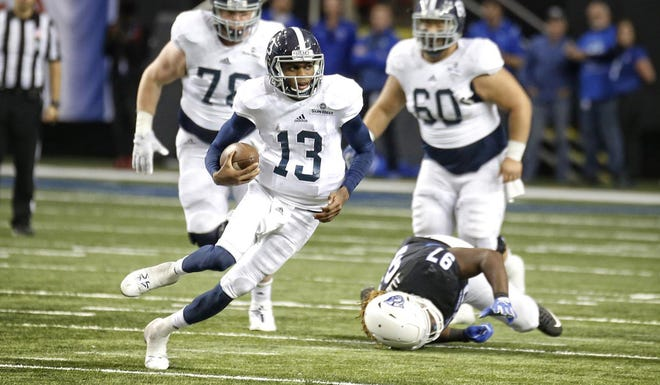 Favian Upshaw, shown during his playing career as a quarterback for Georgia Southern, has been hired as the Eagles' running backs coach.
