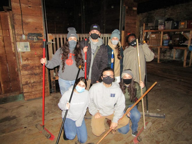 A group of college students from Florida spent their spring break cleaning up the former Furniture Country location in Kewanee, purchased last year by Jesus and Liz Bermudez who have opened The Kewanee House of Prayer in a portion of the complex. Taking a break from sweeping in front of a service elevator are, front row from the left: Kayla Hemby, Kevin Krienitz and Aliesa Boisvert. Standing: Kailey Walck, Josh Garboski, Hannah Johnston and Paulina Baidoo.