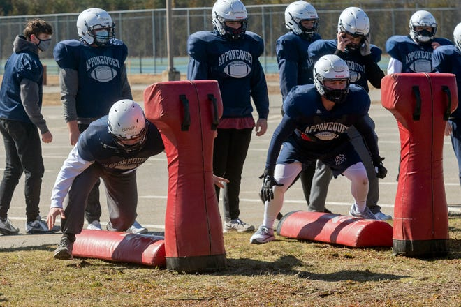Apponequet football players Vincent Olivieri and Kobe Desousa work on tackling and blocking, as the Lakers got back to work last week in preparation for the MIAA Fall II season. Apponequet kicks off the spring football season March 26 vs. New Bedford Voc-Tech.