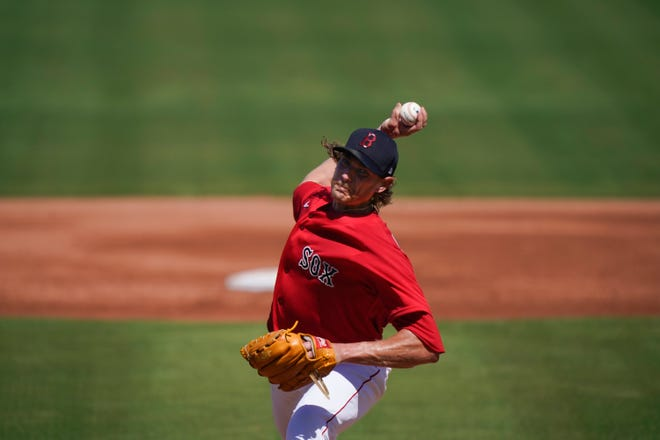 Boston Red Sox starting pitcher Garrett Richards throws during a game March 1 in Fort Myers, Fla. Richards struggled again on Sunday against the Braves, giving up four earned runs in two innings.