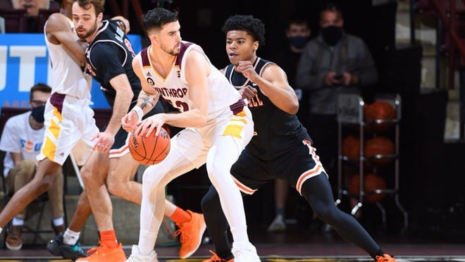 Winthrop's Chandler Vaudrin looks to move the ball as he is defended by Campbell's Ricky Clemons in the Big South championship game on Sunday, March 7, 2021.