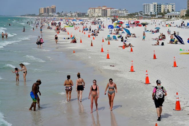 Beachgoers take advantage of the weather as they spend time on Clearwater Beach March 2 in Clearwater, a popular spring break destination, west of Tampa.