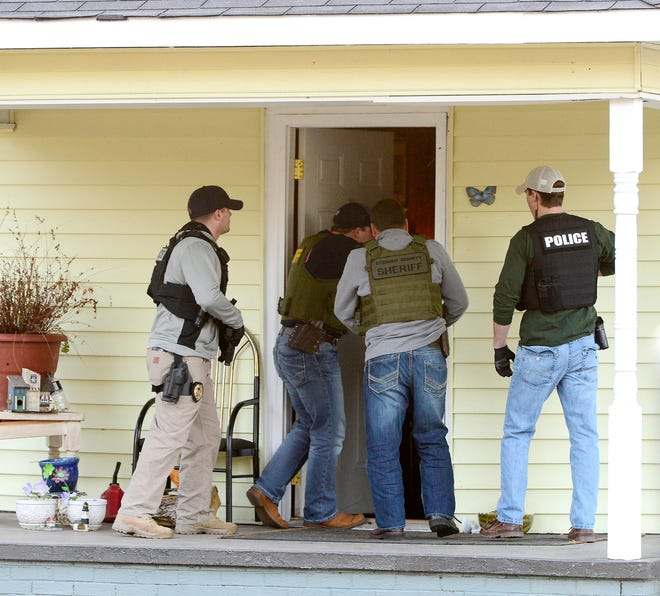 Police enter a house on New York Avenue in East Gadsden during a joint operation of city and county law enforcement personnel in 2017. This year, both the Gadsden Police Department and the Etowah County Sheriff's Office contracted with Lexipol to help with updating policies, ensuring they are within federal, state and local laws, and comparing them with best practices in other law enforcement agencies.