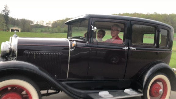 Randy and Nancy Gibbs in their retirement vehicle.
