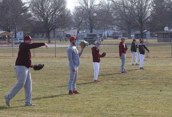 The Dover High School baseball team warms up for practice at Dover City Park. The high school baseball season kicks off March 27.
