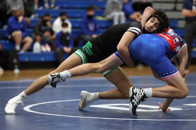 Omar Ayoub won the Division I district championship at 113 pounds and helped the Shamrocks capture their third consecutive team title March 7 at Hilliard Darby.