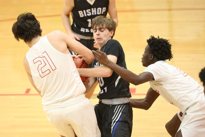 Ready junior guard Troy Hixson battles St. Charles' Ryan Utt for possession of the ball earlier this season. The Silver Knights reached a Division III district semifinal, finishing 12-7 overall and 4-4 in the CCL.