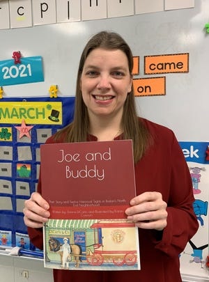"""Mansfield kindergarten teacher Donna DiCarlo wrote """"Joe and Buddy,"""" a new children's book about Boston's North End. The book is illustrated by Mansfield paraprofessional Karen Connors."""