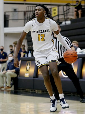 Moeller High School guard Evan Mahaffey moves the ball against Miamisburg in a Division I boys district final at Centerville March 6, 2021.  Moeller won 75-54.