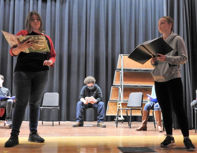"""Isabella Knicely and Anna Richcreek rehearse a scene from """"Twisted Tales of Poe"""" a radio show students will be performing with sound effects. The notion was a radio show, over a conventional play, would be able to adhere to pandemic guidelines and policies."""