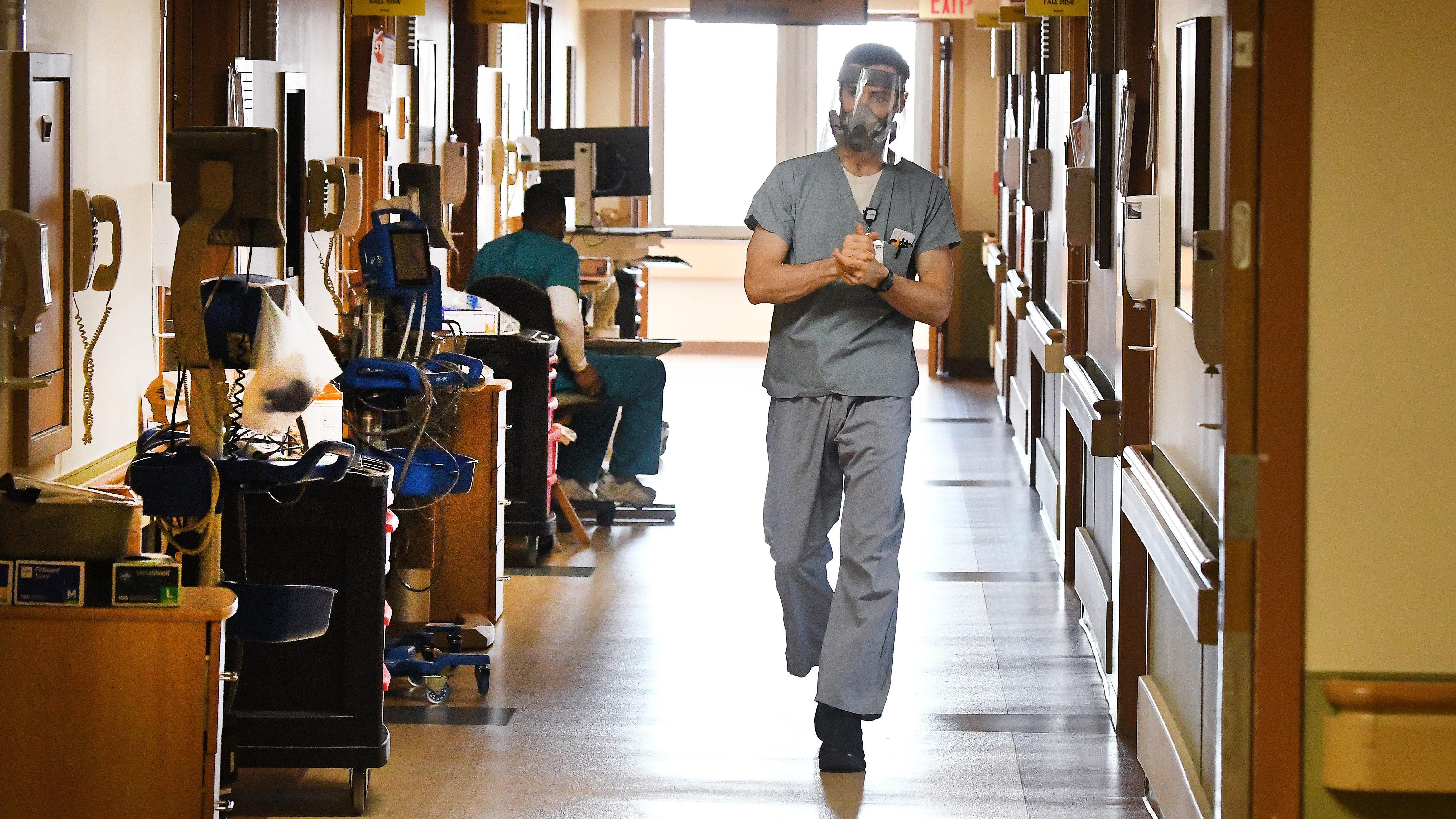 Registered nurse Spencer Carlson works in the Beaumont Dearborn Hospital COVID-19 unit in March 2021. Some older nurses decided to retire after the difficulties generated by the coronavirus and caring for patients, Michigan hospital officials said.