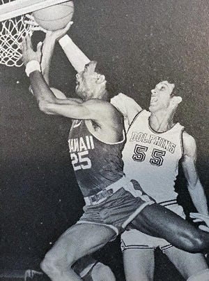 Greg Nelson (55), a Harrison Hall of Famer, blocks a shot for Jacksonville. He was a top reserve on the Dolphins' 1970 NCAA runner-up team.