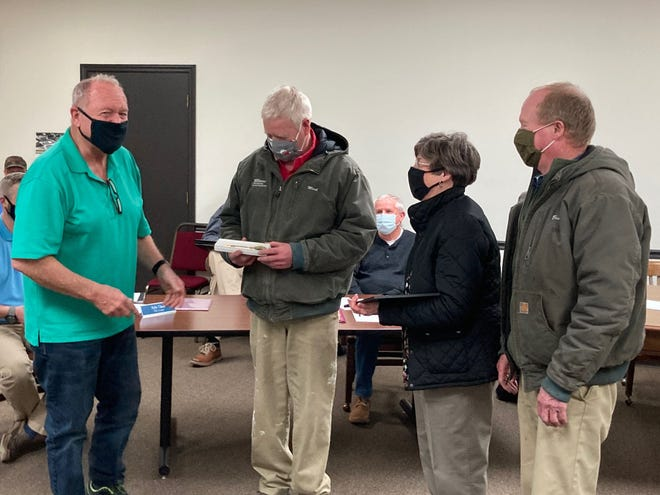 Morganfield Mayor Randy Greenwell, left, presented a resolution honoring the late Thomas Danhauer to three of his children, from the left, Mark Danhauer, Linda Williamson and Bruce Danhauer at the Feb. 25 City Council meeting.