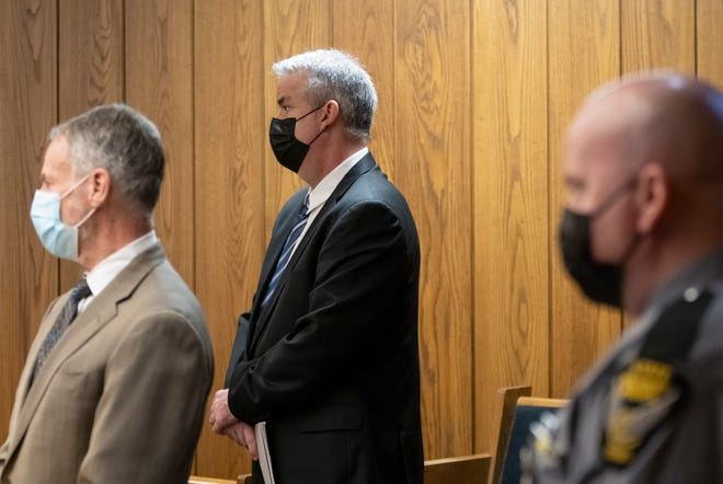 Marion County judge Jason Warner, middle, resigned from his position as judge after being convicted of two felonies related to a hit-skip crash in 2020.