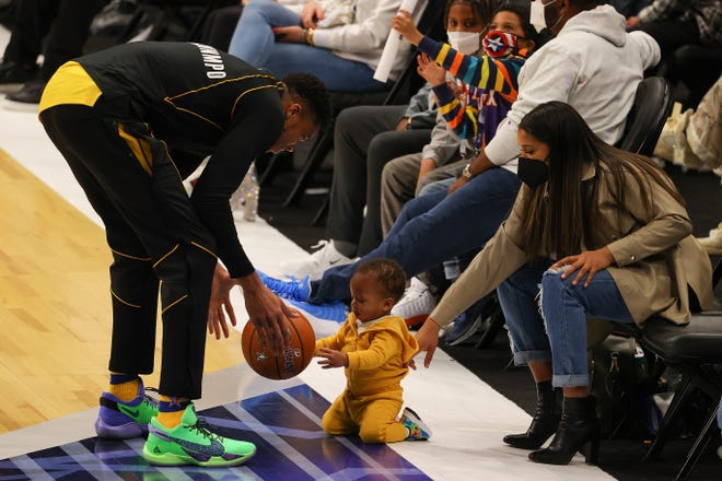 Giannis Antetokounmpo plays with his son Liam before the All-Star Game.