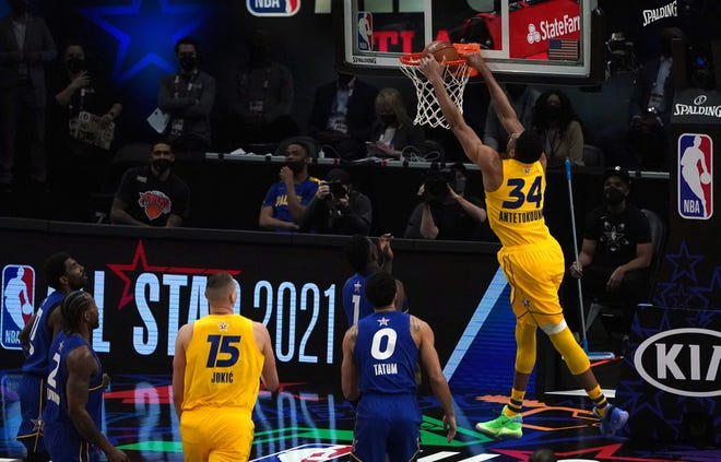Giannis Antetokounmpo rises for a dunk in the 70th NBA All-Star Game at State Farm Arena in Atlanta Sunday.