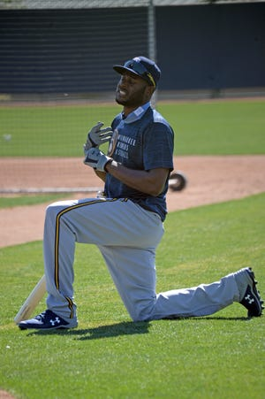"""Brewers centerfielder Lorenzo Cain came out """"too hot, too soon"""" trying to work  himself back into baseball shape after nearly a season away from the game."""