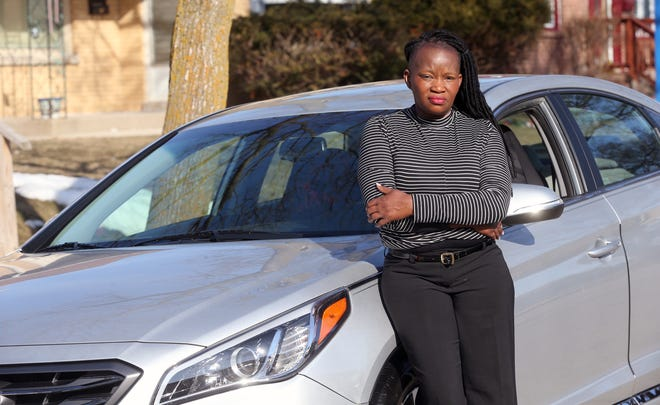 Dorothy Smith is pictured with her 2015 Hyundai Sonata on Monday, March 8, 2021. Smith's previous car, a 2017 Hyundai Elantra, was stolen and she was left with thousands of dollars worth of damage. She bought a new car, but worries that her car can be stolen again because of the stolen car crisis in the Milwaukee.  Nearly 1,500 cars have been stolen in the city just this year.