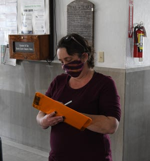 April Stacey casts an early vote in the Mountain Home special election Monday afternoon at the Baxter County Courthouse.