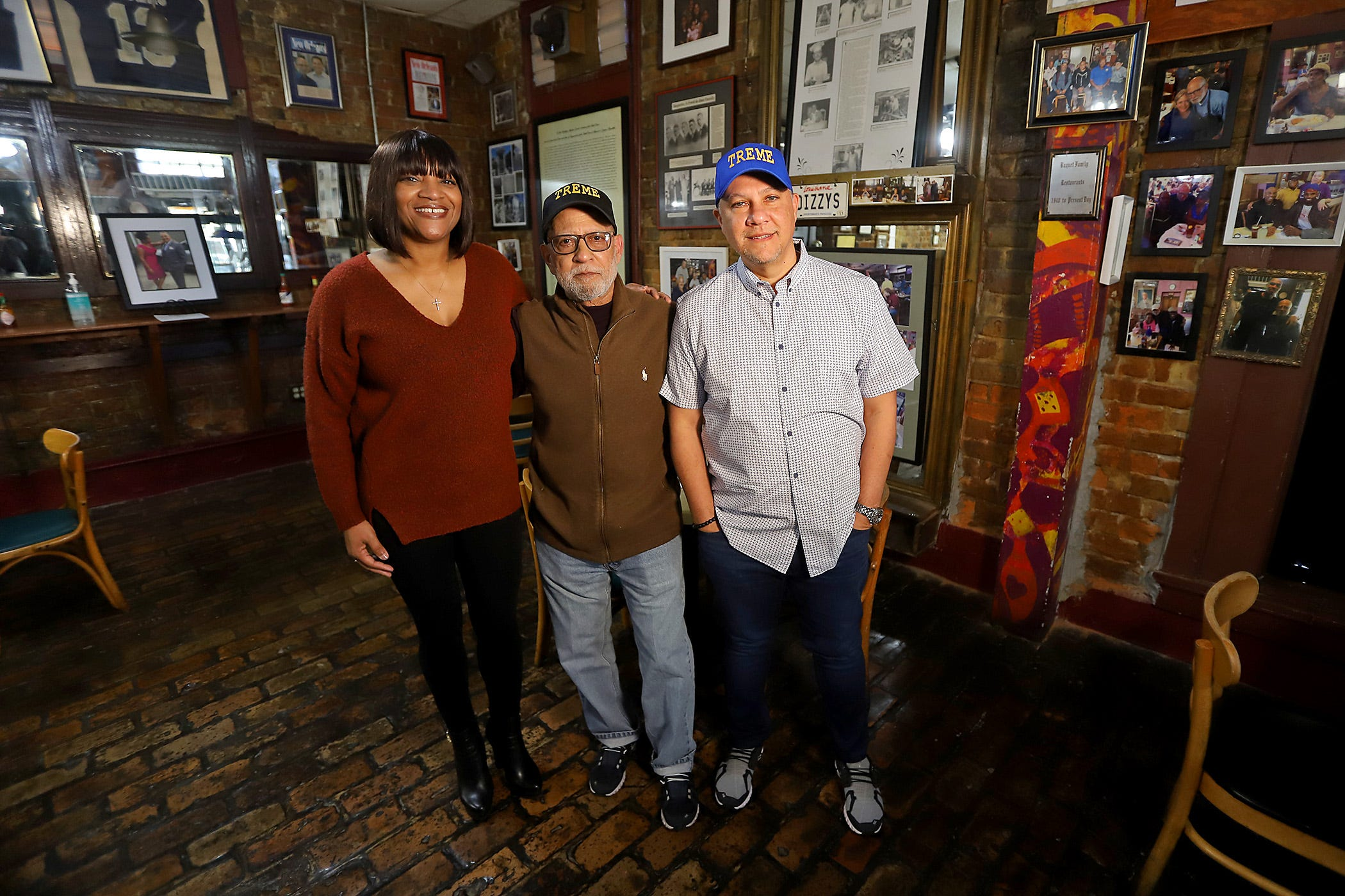 (L to R) Arkesha Baquet, Wayne Baquet Sr. and Wayne Baquet Jr. at Li'l Dizzy's Cafe in the Treme neighborhood of New Orleans. Photographed on Sunday, March 7, 2021.