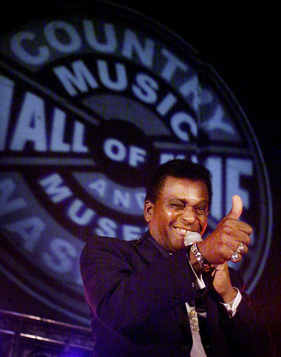 An exuberant Charley Pride, while singing a few songs, flashes a thumbs up to a friend in the audience after receiving a medallion along with the family of Faron Young commemorating their 2000 inductions into the Country Music Hall of Fame on March 13, 2001.