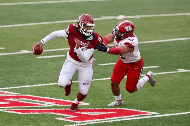 Jonah Johnson (10) scrambles as New Mexico State takes on Dixie State at the Sun Bowl in El Paso, Texas on Sunday, March 7, 2021.