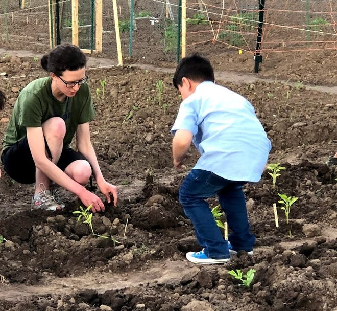 Margaret Franchino, left, community gardens coordinator for Brown County, says plots are open to anyone but fill up each spring. Registration opens April 15.