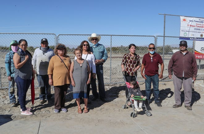 Oasis residents show their support for the Oasis Community Park, which is under construction near Avenue 76 and Harrison Street in Oasis, Calif., March 5, 2021.