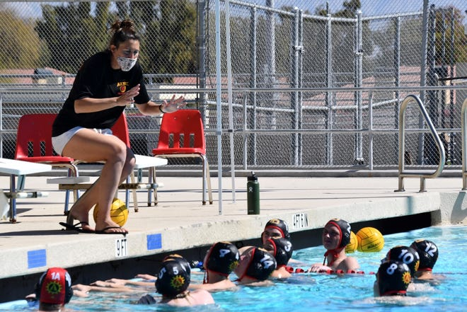 Palm Desert coach Michelle Valovic shouts instructions through a mask during Saturday's game against Xavier Prep.