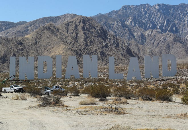 'Never Forget' by artist Nicholas Galanin sits several stories tall on an alluvial fan near Tramway Rd and Hwy 111 in Palm Springs, March 5, 2021.  The work is part of the Desert X exhibition.