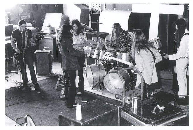 "The classic Alice Cooper lineup with famed producer Bob Ezrin in their Pontiac, Michigan barn, where they worked up the songs for 1970's ""Love It to Death"" and ""Killer"" albums."