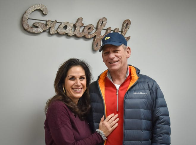 Rose and Doug Sabin stand inside their business, Soul Stretch Yoga, where Rose teaches a variety of yoga classes and Doug teaches Yoga for Recovery classes for people in recovery and their family members. Yoga for Recovery integrates yoga into an AA meeting.