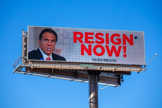A billboard urging New York Gov. Andrew Cuomo to resign is seen near downtown Albany, New York, on March 2, 2021. The governor is facing calls to resign after three women have come forward accusing him of unwanted advances. (Matthew Cavanaugh/Getty Images/TNS)