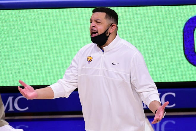 Pittsburgh head coach Jeff Capel gestures to his team during the first half of an NCAA college basketball game, Tuesday, March 2, 2021, in Pittsburgh. (AP Photo/Fred Vuich)