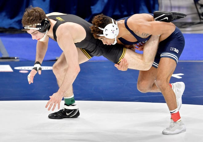 Penn State's Roman Bravo-Young trips up Iowa's Austin DeSanto in the 133-pound championship bout at the 2021 Big Ten Wrestling Tournament at the Bryce Jordan Center in State College, Pa, on Sunday, March 7, 2021. (Abby Drey/Centre Daily Times via AP)