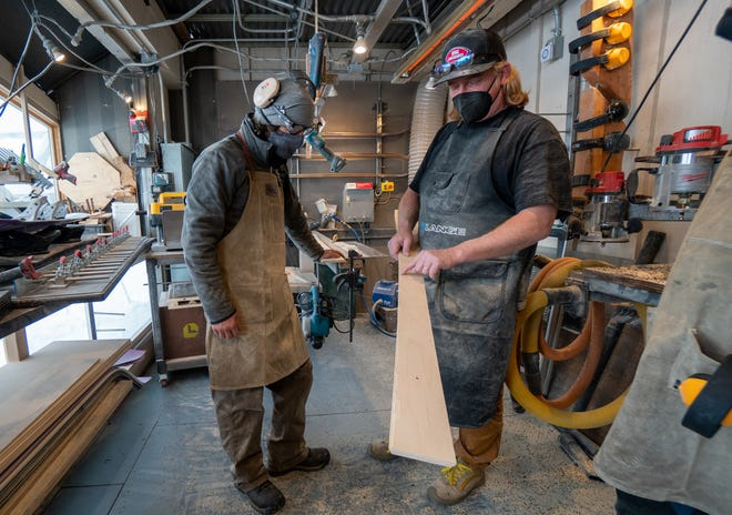 Hank Gulledge, right, manager of Santiam SnoLab, works with a student through the ski core routing process while building a new set of skis near Hoodoo Ski Area.