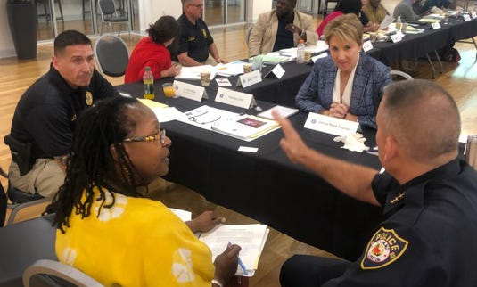 """Lorie Fridell, at right, professor of criminology at the University of South Florida, hosts a small-group training for law enforcement. """"If you try to screen and find people who don't have internal bias you aren't going to have anyone to hire,"""" she said. Instead, you need officers who are aware of and can deal with their bias to make fair decisions."""