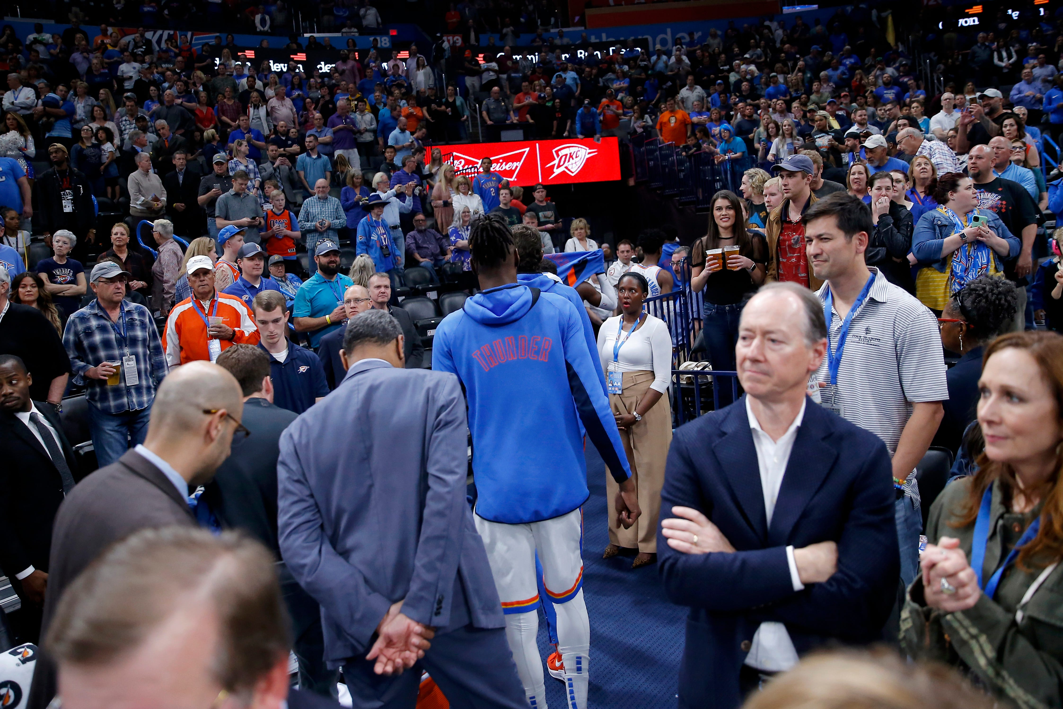 Oklahoma City Thunder players leave the court after their game against the Utah Jazz was canceled because of COVID-19 concerns.