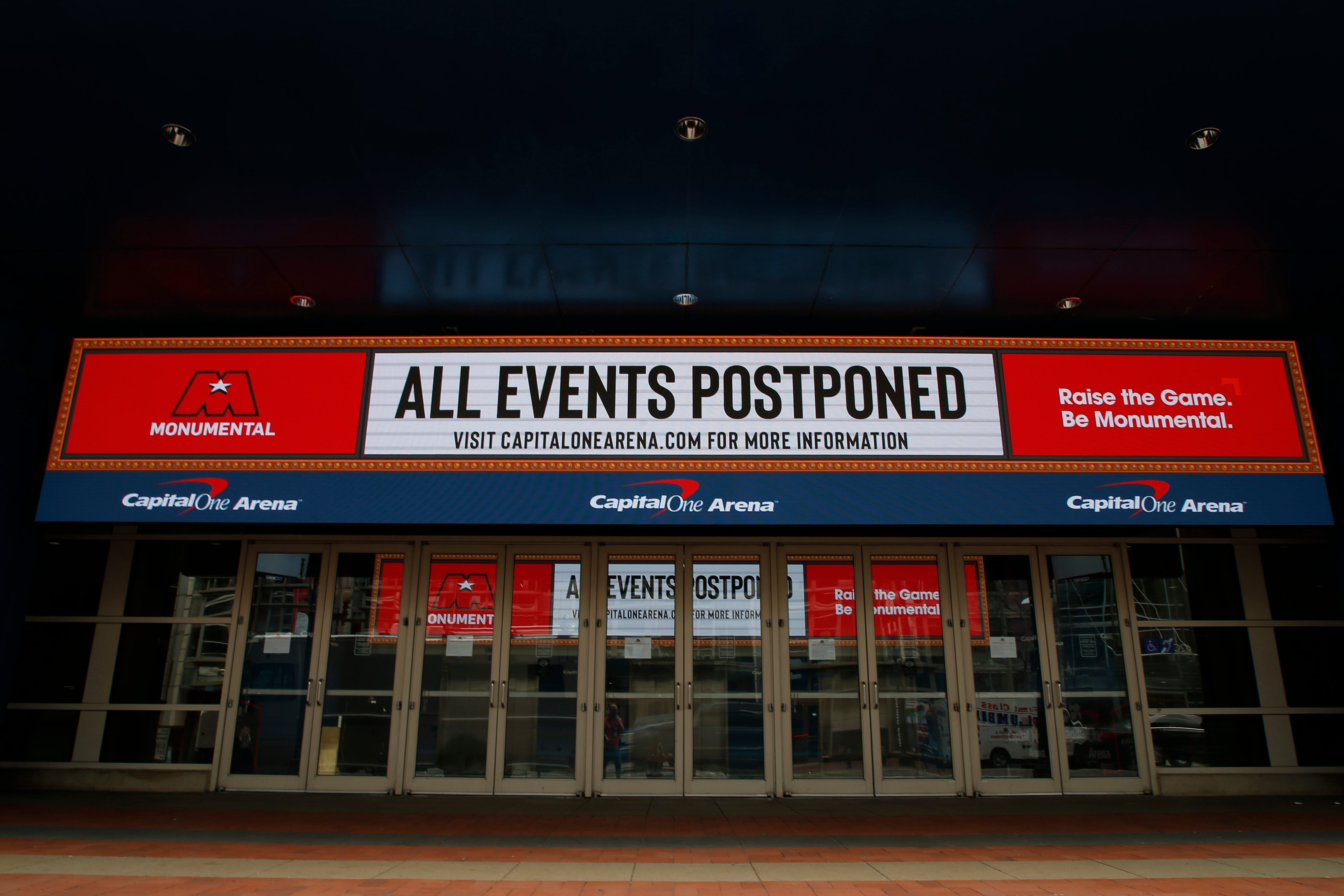 The marquee outside the Capital One Arena, home of the NBA's Washington Wizards and NHL's Washington Capitals, announces the suspension of their 2020 seasons during the coronavirus pandemic.