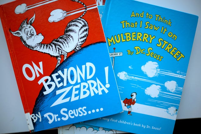 """Dr. Seuss Enterprises discontinued some books, including """"On Beyond Zebra!"""" and """"And to Think That I Saw it on Mulberry Street,"""" over concerns about insensitive imagery."""