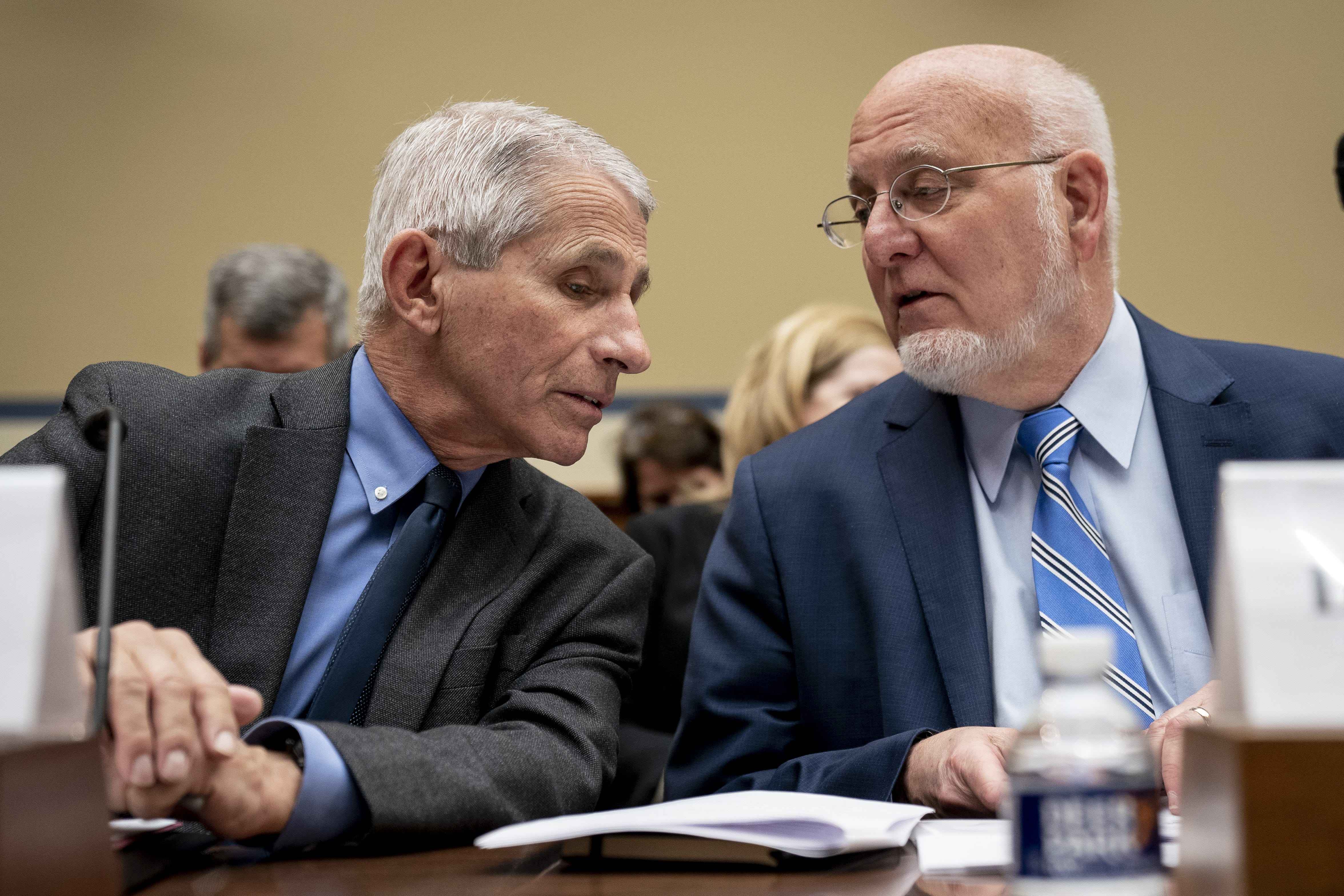 WASHINGTON, DC - MARCH 11: (L-R) Dr. Anthony Fauci, Director, National Institute of Allergy and Infectious Diseases at National Institutes of Health, and Dr. Robert Redfield, director of the Centers for Disease Control and Prevention (CDC), talk with each other at the start of a House Oversight And Reform Committee hearing concerning government preparedness and response to the coronavirus, in the Rayburn House Office Building on Capitol Hill March 11, 2020 in Washington, DC. Since December 2019, coronavirus (COVID-19) has infected more than 109,000 people and killed more than 3,800 people in 105 countries. (Photo by Drew Angerer/Getty Images) ORG XMIT: 775494460 ORIG FILE ID: 1206551329