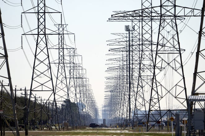 This Feb. 16, 2021 file photo shows power lines in Houston.