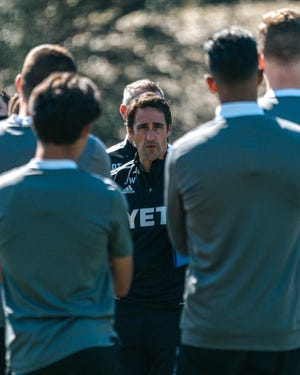 Austin FC coach Josh Wolff talks to his squad during a team preseason training session at St. Edward's University. Wolff looks forward to this week's scrimmage against the USL's Oklahoma City Energy FC.