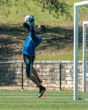 Austin FC goalkeeper Andrew Tarbell makes a stop during a team preseason training session at St. Edward's University.