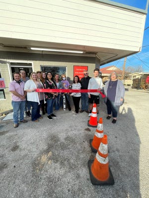 The Smithville Chamber of Commerce last week hosted a ribbon cutting ceremony for Clint's Liquor at 104 NE Loop 230.