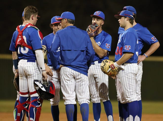 """Westlake coach JT Blair talks to his players in a game last season. The coach is optimistic for 2021, saying """"we have some good, young athletic players, have some speed in the lineup and have some guys that can bash a little bit, too."""""""
