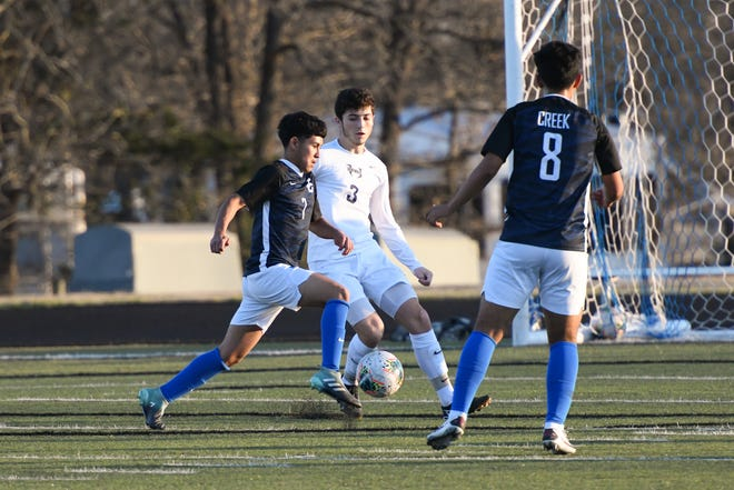 Cedar Creek's Jesse Martinez (with ball) scored a hat trick in his team's win over Manor.