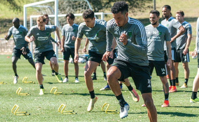 Austin FC defender Julio Cascante warms up before a team preseason training session at St. Edward's University. The club will open up its 2021 season with a match at Los Angeles FC on April 17.