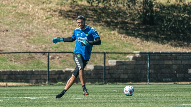 Austin FC goalkeeper Andrew Tarbell plays a pass during a team preseason training session at St. Edward's University. The former Columbus Crew SC  player is expected to take over starting netminder duties for his new club this season.